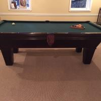 Brunswick Pool Table and cue sticks